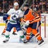 Michael Del Zotto Photos - Connor McDavid #97 of the Edmonton Oilers battles against Michael Del Zotto #4 of the Vancouver Canucks at Rogers Place on January 20, 2018 in Edmonton, Canada. - Vancouver Canucks v Edmonton Oilers