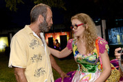 Artists Kenny Scharf (L) and Olek attend Vanity Fair And Cadillac Toast The Artists Of Wynwood Walls at Wynwood Kitchen & Bar on December 4, 2013 in Miami, Florida.