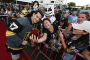 Max Pacioretty #67 of the Vegas Golden Knights poses for photos with fans as he arrives at the Vegas Golden Knights Fan Fest at the Downtown Las Vegas Events Center on September 19, 2018 in Las Vegas, Nevada.