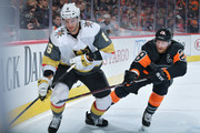 Colin Miller #6 of the Vegas Golden Knights gets stick checked by Claude Giroux #28 of the Philadelphia Flyers at the Wells Fargo Center on October 13, 2018 in Philadelphia, Pennsylvania.