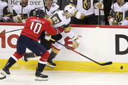 Brett Connolly #10 of the Washington Capitals checks Max Pacioretty #67 of the Vegas Golden Knights during the first period at Capital One Arena on October 10, 2018 in Washington, DC.