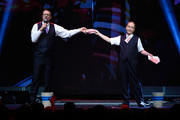 Penn Jillette (L) and Teller of the comedy/magic team Penn & Teller perform at the Vegas Strong Benefit Concert at T-Mobile Arena to support victims of the October 1 tragedy on the Las Vegas Strip on December 1, 2017 in Las Vegas, Nevada.