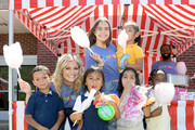 Lauren Alaina and Bailee Madison take photos with kids during Vera Bradley x Blessings In A Backpack event on August 28, 2019 in Nashville, Tennessee.