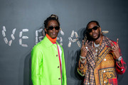 Young Thug and 2 Chainz attend the the Versace fall 2019 fashion show at the American Stock Exchange Building in lower Manhattan on December 02, 2018 in New York City.