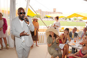 Wyclef Jean and Donna Karan attend the Veuve Clicquot Polo Classic at Governor's Island on June 5, 2011 in New York City.