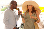 Wyclef Jean and Donna Karan speak at the Veuve Clicquot Polo Classic at Governor's Island on June 5, 2011 in New York City.