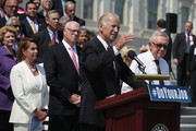 """U.S. Vice President Joseph Biden speaks as Senate Minority Leader Sen. Harry Reid (D-NV), House Minority Leader Rep. Nancy Pelosi (D-CA) and other Senate and House Democrats listen during a press event on the House East Front Steps of the Capitol September 8, 2016 in Washington, DC. Congressional Democrats urge the Republicans to """"do your job!"""""""