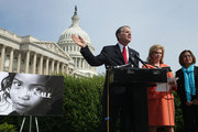 U.S. House of Representatives Victims' Rights Caucus Chairman Rep. Ted Poe (R-TX) (C) and Rep. Carolyn Maloney (D-NY) (2nd R) hold a news conference to discuss human trafficking legislation with survivor Shandra Woworuntu outside the U.S. Capitol May 20, 2014 in Washington, DC. A native of Indonesia, Woworuntu graduated from college and worked at the Korea Exchange Bank before becoming a victim of human trafficking and sold into sexual slavery in New York City. The bipartisan lawmakers urged their colleagues to vote for The Justice for Victims of Trafficking Act and The Human Trafficking Fraud Enforcement Act of 2014.