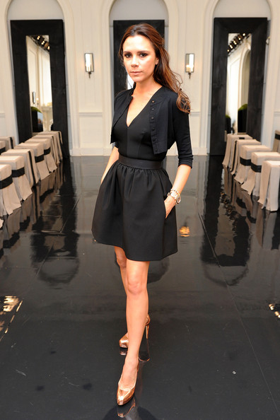 Victoria Beckham Victoria Beckham poses backstage at the Victoria Beckham Dresses Spring 2011 presentation during Mercedes-Benz Fashion Week at  on September 12, 2010 in New York City.