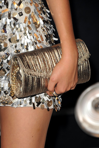 Victoria Justice Actress Victoria Justice (handbag detail) arrives at the 2011 MTV Video Music Awards at Nokia Theatre L.A. LIVE on August 28, 2011 in Los Angeles, California.