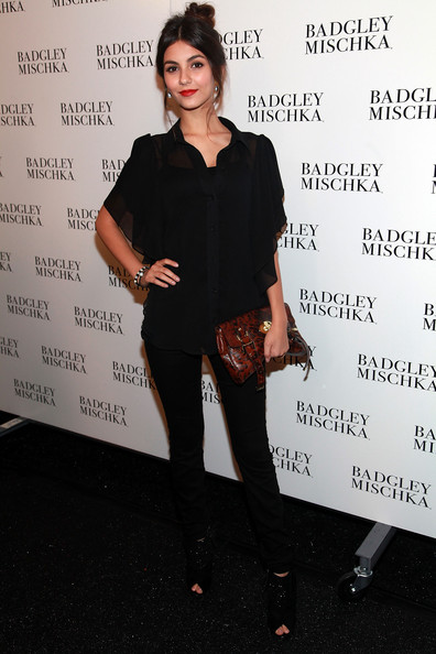 Victoria Justice Actress Victoria Justice poses backstage at the Badgley Mischka Spring 2012 fashion show during Mercedes-Benz Fashion Week at The Theater at Lincoln Center on September 13, 2011 in New York City.