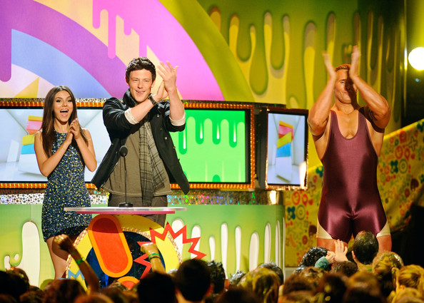 Victoria Justice (L-R) Actress/Singer Victoria Justice and actor Cory Monteith stand at the podium onstage during Nickelodeon's 24th Annual Kids' Choice Awards at Galen Center on April 2, 2011 in Los Angeles, California.