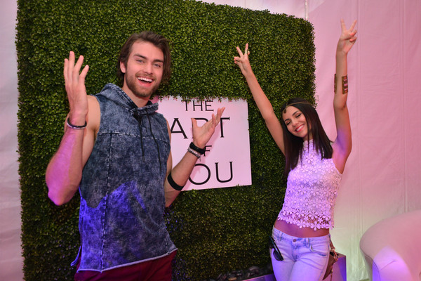 PANDORA Jewelry Experience Inspires Festival Fashion Insiders With Runway Shows, Exclusive Brand Activations - Day 1 [runway shows,purple,fun,pink,gesture,photography,finger,event,hand,happy,party,insiders,pierson fode,victoria justice,exclusive brand activations,siwy denim,palm springs,california,pandora jewelry experience inspires festival fashion,fashion show]