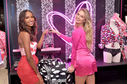 Jasmine Tookes (L) and Romee Strijd attend Victoria's Secret Angels Jasmine Tookes and Romee Strijd Share The Perfect Gifts for Valentine's Day on February 07, 2019 in Los Angeles, California.