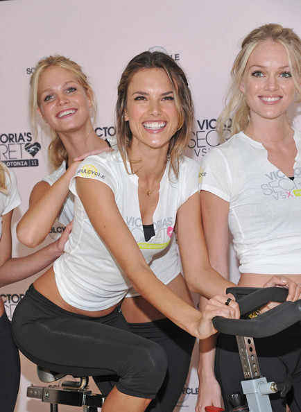 (L-R) Victoria's Secret models Erin Heatherton, Alessandra Ambrosio, and Lindsay Ellingson attend the Victoria's Secret Supermodel cycle to benefit cancer at SoulCycle Tribeca on July 12, 2011 in New York City.