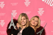 (L-R) Victoria's Secret models Devon Windsor and Rachel Hilbert depart for Paris for the 2016 Victoria's Secret Fashion Show on November 27, 2016 in New York City.