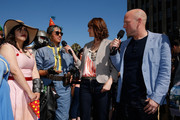 Co-hosts Morgan Webb and Adam Sessler talk with cosplayers lined up outside of the Dolby Theatre ahead of the Bethesda E3 2015 press conference on June 14, 2015 in Los Angeles, California. The Bethesda press conference is held in conjunction with the annual Electronic Entertainment Expo (E3) which focuses on gaming systems and interactive entertainment, featuring introductions to new products and technologies.