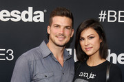 Actor Rick Malambri poses for a photograph with guest as he arrives to the Bethesda E3 2015 press conference at the Dolby Theatre on June 14, 2015 in Los Angeles, California. The Bethesda press conference is held in conjunction with the annual Electronic Entertainment Expo (E3) which focuses on gaming systems and interactive entertainment, featuring introductions to new products and technologies.