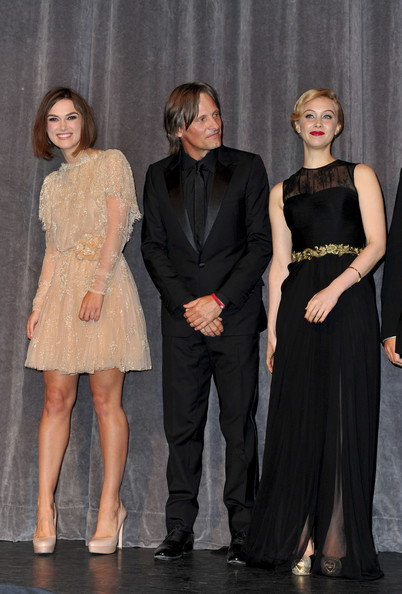 "Viggo Mortensen (L-R) Actors Keira Knightley, Viggo Mortensen and Sarah Gadon stand onstage at ""A Dangerous Method"" Premiere at Roy Thomson Hall during the 2011 Toronto International Film Festival on September 10, 2011 in Toronto, Canada."