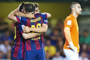 Sandro (R) of Barcelona celebrate after scoring with his team-mates Jordi Alba and Lionel Messi during the La Liga match between Villarreal CF and FC Barcelona at El Madrigal stadium on August 31, 2014 in Villarreal, Spain.