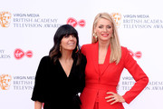 Claudia Winkleman (L) and Tess Daly attend the Virgin Media British Academy Television Awards 2019 at The Royal Festival Hall on May 12, 2019 in London, England.