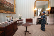 Queen Elizabeth II appears on a screen by videolink from Windsor Castle, where she is in residence, during a virtual audience to receive Her Excellency Sara Affoue Amani, the Ambassador of Cote d'Ivoire at Buckingham Palace on April 27, 2021 in London, England.