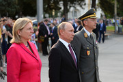 Austrian Foreign Minister Karin Kneissl and Russian President Vladimir Putin take part in a wreath laying ceremony at the Soviet war memorial at Schwarzenbergplatz in Vienna on June 5, 2018 in Vienna, Austria. Putin is in Vienna to commemorate the 50th anniversary of the completion of a pipeline that transports Russian gas to Europe.