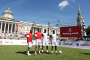 (L-R) Ex Arsenal legends Ian Wright and Tony Adams and Ex Tottenham Hostspur legends Ledley King and Les Ferdinand during the Vodafone 4G Goes Live Launch at Trafalgar Sqaure on August 29, 2013 in London, United Kingdom.  Vodafone kicks off 4G network in London with a choice of Sky Sports TV or Spotify Premium, before launching in 12 more cities before the end of the year.