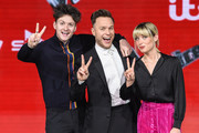 (L-R) Jimmy Balito, Olly Murs and Molly Hocking attend The Voice UK Final 2019 photocall at Elstree Studios on April 4, 2019 in Borehamwood, England.