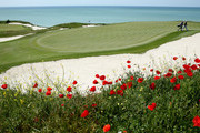 Francesco Molinari of Italy and his caddie Jason Hempelman walk off the green on the 16th hole during the last 16 matches on Day Three of the Volvo World Match Play Championship at Thracian Cliffs Golf & Beach Resort on May 18, 2013 in Kavarna, Bulgaria.