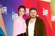"""Raffey Cassidy (L) and director Brady Corbet attend the UK Premiere of """"Vox Lux"""" at the 62nd BFI London Film Festival on October 15, 2018 in London, England."""