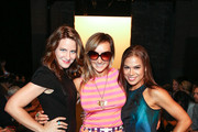 (L-R) Amy Trucks, designer / TV personality Nikki Poulos and actress Toni Trucks attend the Voz fashion show during Mercedes-Benz Fashion Week Spring 2014 at Eyebeam on September 12, 2013 in New York City.