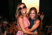 Designer / TV personality Nikki Poulos (L) and actress Toni Trucks attend the Voz fashion show during Mercedes-Benz Fashion Week Spring 2014 at Eyebeam on September 12, 2013 in New York City.