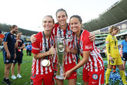(L-R) Jessica Fishlock, Rebekah Stott and Lauren Barnes of Melbourne City celebrate victory during the W-League Grand Final match between Sydney FC and Melbourne City FC at Allianz Stadium on February 18, 2018 in Sydney, Australia.