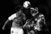 Image has been converted to black and white.). Wai Ki Cheung and Abbey Lloyd of the Roar compete for the ball with Maruschka Waldus of the Wanderers during the round three W-League match between the Western Sydney Wanderers and the Brisbane Roar at Marconi Stadium on November 10, 2017 in Sydney, Australia.
