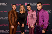 "(2nd from L) Rita Wilson, (L-R) Kevin Jonas, Nick Jonas, and Joe Jonas of The Jonas Brothers  attends WCRF's ""An Unforgettable Evening"" at Beverly Wilshire, A Four Seasons Hotel on February 27, 2020 in Beverly Hills, California."