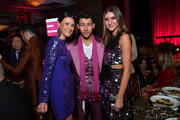 "(L-R) Lizzie Tisch, Nick Jonas of The Jonas Brothers, and Mason Rudnick attends WCRF's ""An Unforgettable Evening"" at Beverly Wilshire, A Four Seasons Hotel on February 27, 2020 in Beverly Hills, California."