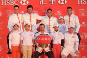 (L to R) Chinese Golf Association young golfers join Justin Rose of England, Bubba Watson of the United States, Adam Scott of Australia, Rickie Fowler of the United States and Martin Kaymer of Germany atop the Peninsula Hotel prior to the start of the WGC - HSBC Champions on November 4, 2014 in Shanghai, China.
