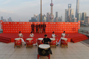 (L to R) Henrik Stenson of Sweden, Rickie Fowler, Jordan Spieth and Bubba Watson of the United States watch drummers on stage during a photocall for the WGC - HSBC Champions at The Peninsula on November 3, 2015 in Shanghai, China.
