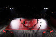 Rory McIlroy of Northern Ireland, Brooks Koepka of the United States, Justin Rose of England and Francesco Molinari of Italy play badminton during a photocall prior to the WGC - HSBC Champtions at the Chamber of Commerce Shanghai on October 23, 2018 in Shanghai, China.