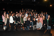 """(L-R) Actors Chris Evans (C) and Jeremy Renner (C) pose with SCAD students at """"Wind River"""" special screening at SCADShow on November 29, 2017 in Atlanta, Georgia."""