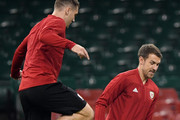 Sam Vokes looks on as Aaron Ramsey controls the ball during a Wales Training Session at Principality Stadium on October 10, 2018 in Cardiff, Wales.