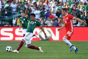 Jesus Gallardo #23 intercepts a pass intended for Aaron Ramsey #10 of Wales during the first half of their friendly international soccer match at the Rose Bowl on May 28, 2018 in Pasadena, California.