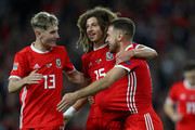 David Brooks and Ethan Ampadu of Wales congratulate Aaron Ramsey of Wales after he scores his teams third goal during the UEFA Nations League B group four match between Wales and Republic of Ireland at Cardiff City Stadium on September 6, 2018 in Cardiff, United Kingdom.