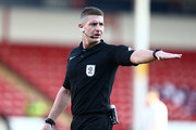Referee Robert Jones in action during the Sky Bet League One match between Walsall and Northampton Town at Banks' Stadium on February 4, 2017 in Walsall, England.
