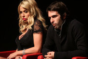"""Actress Valeria Marini (L) and director Christian Molina speak on stage at the """"I Want To Be  A Soldier"""" press conference during the 5th International Rome Film Festival at Auditorium Parco Della Musica on November 2, 2010 in Rome, Italy."""