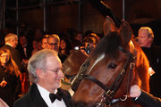 Director Steven Spielberg poses with Joey, the War Horse during the UK premiere of War Horse at Odeon Leicester Square on January 8, 2012 in London, England.