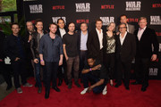 """(L-R) Scoot McNairy, Alan Ruck, Topher Grace, Emory Cohen, Jeremy Kleiner, David Michod, Ted Sarandos, Lakeith Stanfield, Brad Pitt, Meg Tilly, Griffin Dunne, Scott Stuber, and Anthony Michael Hall attend a special screening of the Netflix original film """"War Machine"""" at The Metrograph on May 16, 2017 in New York City."""