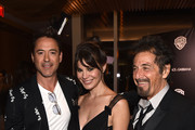(L-R) Actor Robert Downey Jr., Lucila Sola and actor Al Pacino attend the Warner Bros. Pictures and Dolce & Gabbana TIFF cocktail party during the 2014 Toronto International Film Festival at Momofuku Daisho on September 6, 2014 in Toronto, Canada.
