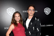 Actor Robert Downey Jr. (R) and Susan Downey attend the Warner Bros. Pictures and Dolce & Gabbana TIFF cocktail party during the 2014 Toronto International Film Festival at Momofuku Daisho on September 6, 2014 in Toronto, Canada.